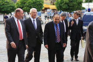 Norman E. Haslun III, C. Douglas Ades, Robert G. Faris, Frederick M. Bohen, Jerzy Koźmiński